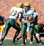 BROOKINGS, SD - SEPTEMBER 28:  Brock Jensen #16 from North Dakota State University hands the ball off to John Crockett #23 in the second quarter of their game against South Dakota State University Saturday afternoon at Coughlin Alumni Stadium in Brookings. (Photo by Dave Eggen/Inertia)