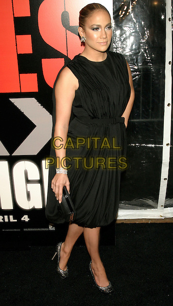 "JENNIFER LOPEZ.New York Premiere of ""Shine A Light"" at the Ziegfeld Theater, New York, NY, USA..March 30th, 2008.full length black dress hand clutch bag purse .CAP/LNC/TOM.©TOM/LNC/Capital Pictures."