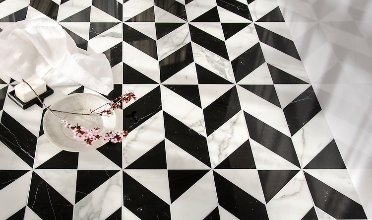 Lancaster Large, a hand-cut stone mosaic, shown in polished Calacatta Tia and Nero Marquina, is part of the Palazzo™ collection by New Ravenna.