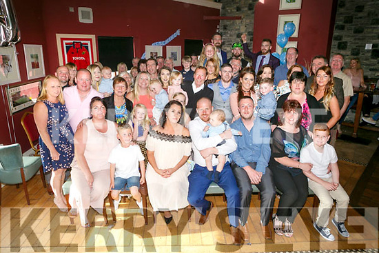 Parents Helen O'Sullivan and John Hill celebrating the christening of Baby Odhran at St. Brendan's Church by Fr. Padraig Walsh on Saturday and after at O'Donnell's Bar with family and friends