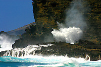 The blow hole at Halona Point spews a mushroom-like formation from its spout.
