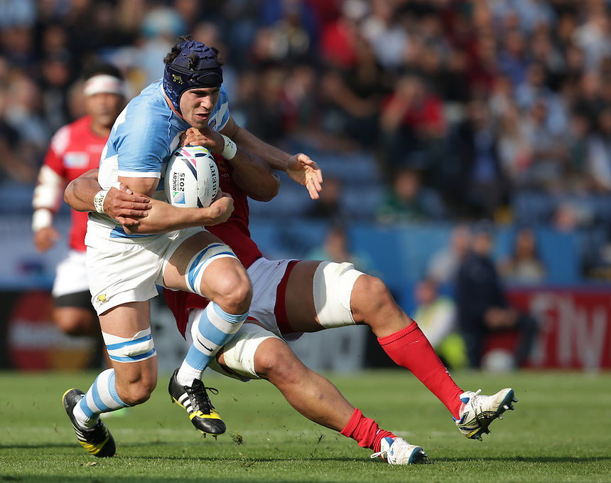 Argentina's Guido Petti Pagadizaval tackled by Tonga's Sione Kalamafoni<br /> <br /> Photographer Stephen White/CameraSport<br /> <br /> Rugby Union - 2015 Rugby World Cup Pool C - Argentina v Tonga - Sunday 4th October 2015 - King Power Stadium - Leicester <br /> <br /> &copy; CameraSport - 43 Linden Ave. Countesthorpe. Leicester. England. LE8 5PG - Tel: +44 (0) 116 277 4147 - admin@camerasport.com - www.camerasport.com