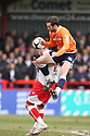 Fred Murray of Luton jumps high to win the ball against Andy Drury of Stevenage Borough  during the  Blue Square Premier match between Stevenage Borough and Luton Town at the Lamex Stadium, Broadhall Way, Stevenage on Saturday 3rd April, 2010..© Kevin Coleman 2010 .