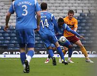 Collin Samuel shielding the ball from Shaun Hutchinson