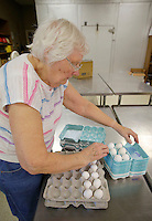 NWA Democrat-Gazette/DAVID GOTTSCHALK  Marilyn Rehbein, an eight year volunteer, divides eggs into smaller containers Wednesday, November 2, 2016, at the Bread of Life food pantry at First United Methodist Church in Springdale.