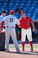 Clearwater Threshers manager Shawn Williams (11) meets with Palm Beach Cardinals manager Dann Bilardello (11) before the first game of a doubleheader against the Palm Beach Cardinals on April 13, 2017 at Spectrum Field in Clearwater, Florida.  Clearwater defeated Palm Beach 1-0.  (Mike Janes/Four Seam Images)