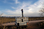 Minuteman Project volunteer Paul of New York monitors the US/Mexico border fence near Naco, Arizona on Saturday, April 2, 2005. The Minuteman Project is an all-volunteer group monitoring the US/Mexico border in Arizona for the month of April, reporting all illegal border crossers to the US Border Patrol.<br />