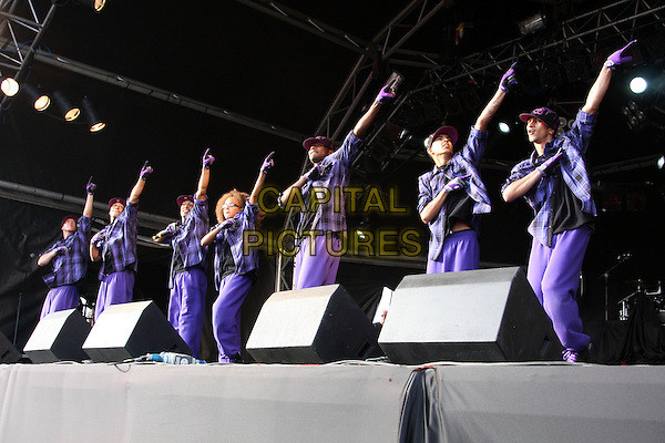 DIVERSITY - PERRI LUC KIELY.Performing live at Pop Picnic In The Park, Shuttleworth Park, Bedfordshire, England, UK, .August 22nd 2010.full length music dancer dancing purple glasses gloves on stage concert gig show arms raised up .CAP/JIL.©Jill Mayhew/Capital Pictures