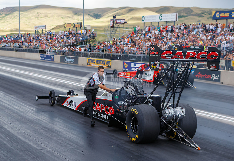 Jul 23, 2016; Morrison, CO, USA; Gary Pritchett , crew member for NHRA top fuel driver Steve Torrence during qualifying for the Mile High Nationals at Bandimere Speedway. Mandatory Credit: Mark J. Rebilas-USA TODAY Sports