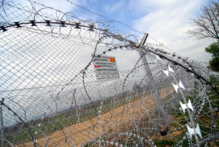 Idomeni / Greece 03/04/2016<br /> Nets and barbed wire erected by the FYROM government to deny the refugees to cross the border.  <br /> Photo Livio Senigalliesi