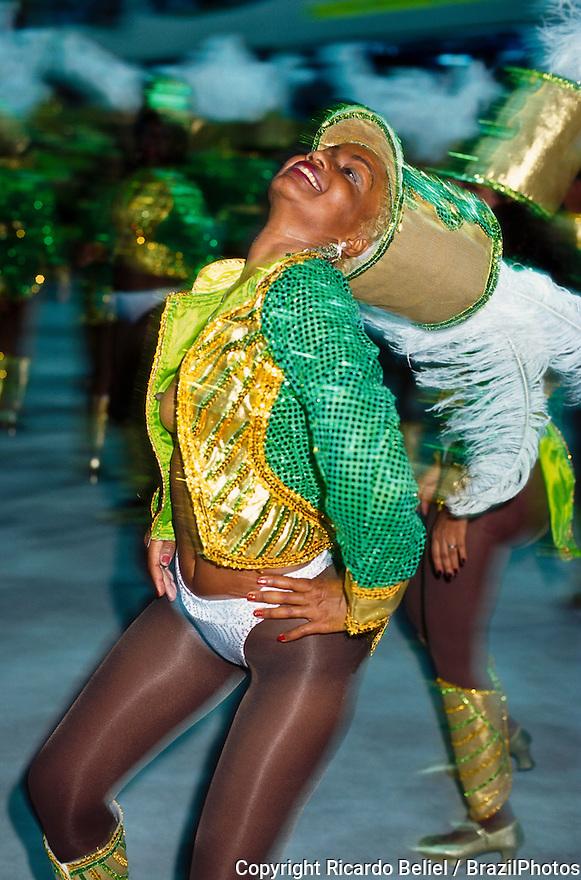 Young and sensual woman with nude breasts dancing at Carnival Samba Schools Parade.