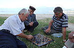 Pogradec-Albania - August 02, 2004---Men concentrating on a chess game at the shore of Lake Ohrid; region/village of project implementation by GTZ-Wiram-Albania (German Technical Cooperation, Deutsche Gesellschaft fuer Technische Zusammenarbeit (GTZ) GmbH); portrait-people-culture---Photo: Horst Wagner/eup-images