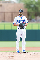 Glendale Desert Dogs starting pitcher Ben Holmes (29), of the Los Angeles Dodgers organization, gets ready to deliver a pitch during an Arizona Fall League game against the Scottsdale Scorpions at Camelback Ranch on October 16, 2018 in Glendale, Arizona. Scottsdale defeated Glendale 6-1. (Zachary Lucy/Four Seam Images)