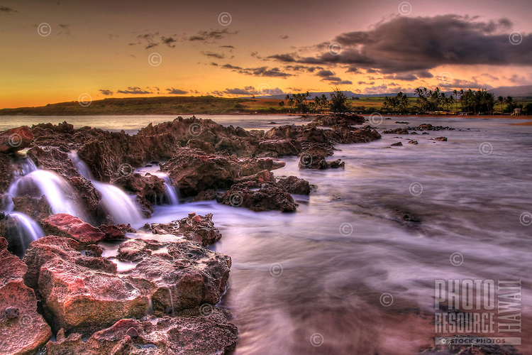 Dramatic sunset from Salt Pond beach park, Kauai, Hawaii.