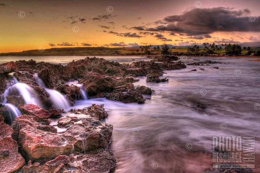 Dramatic sunset from Salt Pond beach park, Kauai, Hawaii.