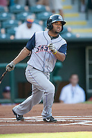 Colorado Springs Sky Sox third baseman Rafael Ynoa (6) watches a ground ball up the first base line at the Chickasaw Bricktown Ballpark during the Pacific League game against the Oklahoma City RedHawks on August 3, 2014 in Oklahoma City, Oklahoma.  The RedHawks defeated the Sky Sox 8-1.  (William Purnell/Four Seam Images)