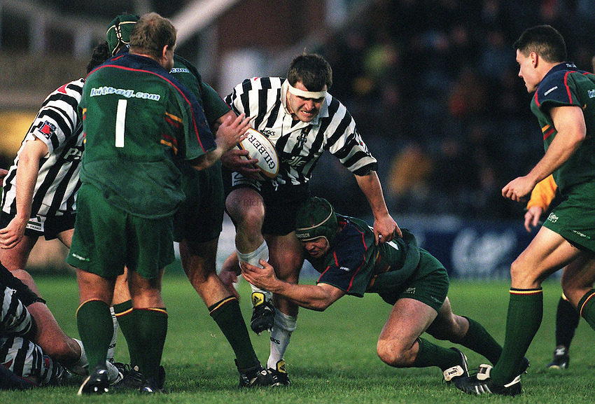 Photo:Ken Brown.20.11.99 London Irish v Brive.Tom Smith charges in tackled by Jake Boer