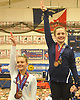 Cassie Bergin of East Islip, right, poses for pictures at the awards podium after taking third place on the balance beam (9.55) in the NYSPHSAA varsity gymnastics state championship meet at Cold Spring Harbor High School on Saturday, March 3, 2018. (Note to editor: Per sportswriter Desiree Mathurin, image is for upcoming unveiling of All Long-Island winter sports selections.)