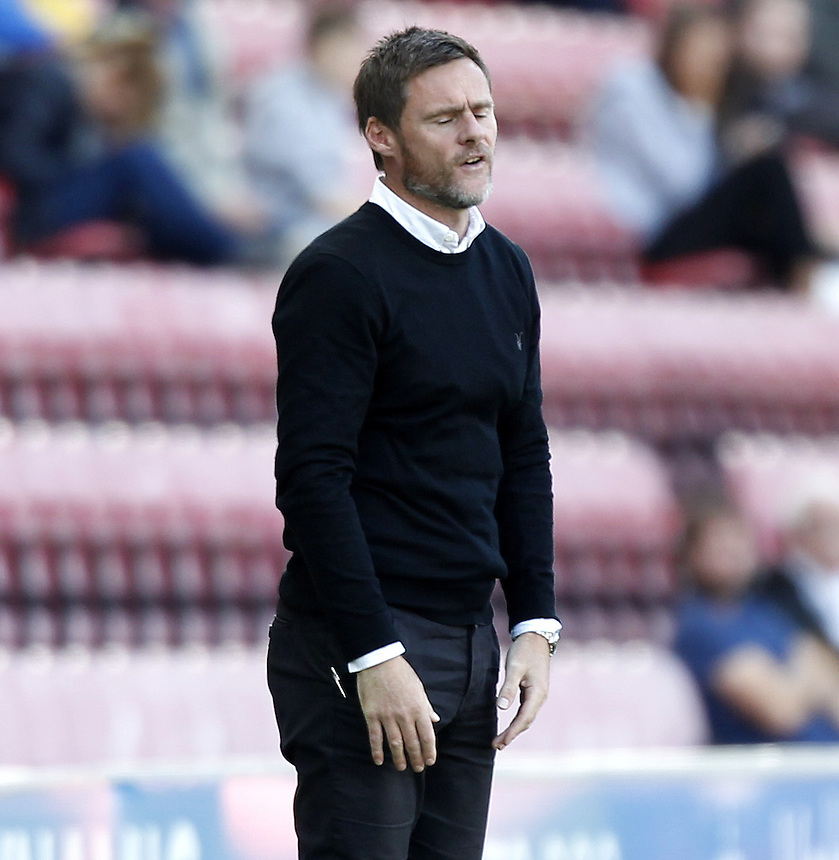 Fleetwood Town's Manager Graham Alexander looks dejected<br /> <br /> Photographer Mick Walker/CameraSport<br /> <br /> Football - The Football League Sky Bet League One - Wigan Athletic v Fleetwood Town - Saturday 19th September 2015 - DW Stadium - Wigan<br /> <br /> &copy; CameraSport - 43 Linden Ave. Countesthorpe. Leicester. England. LE8 5PG - Tel: +44 (0) 116 277 4147 - admin@camerasport.com - www.camerasport.com