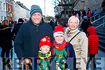 John, Mark James and Valerie Riordan, Leith Cross, Tralee, waiting for Santa at the CH Chemist Christmas parade in Tralee on Saturday afternoon last.