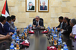 Palestinian Prime Minister Mohammad Ishtayeh meets with a delegation of the General Union of Teachers, at his headquarter, in the West Bank city of Ramallah, June 16, 2019. Photo by Prime Minister Office