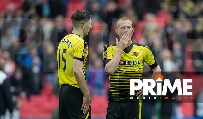Ben Watson of Watford & Craig Cathcart of Watford at the final whistle during the FA Cup Semi Final match between Crystal Palace and Watford at Wembley Stadium, London, England on 24 April 2016. Photo by Andy Rowland.