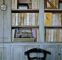 The books and files in this chestnut-panelled library have been covered in goatskin parchment with their titles written by hand on the spines