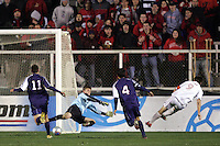Maryland's Jason Garey (9) puts the ball under SMU goalkeeper Matt Wideman in the 47th minute to give Maryland a 3-0 lead. The University of Maryland defeated Southern Methodist University 4-1 in the NCAA Semifinal at SAS Stadium in Cary, North Carolina, Friday, December 9, 2005.