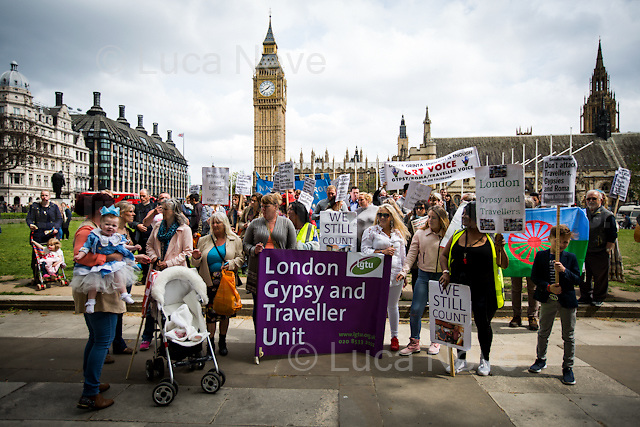 London, 21/05/2016. Today, Travellers, Gypsies and Roma held a demonstration outside the Houses of Parliament against the British Conservative Government alleged plan to abolish Traveller sites weakening the rights of Gypsies, the Roma Community and Parvees (Irish Travellers). From the 38 Degrees online petition ( http://bit.ly/1ORgP9x ): &lt;&lt;[&hellip;] According to the new incarnation of 'gypsy status' that was passed into planning law last year, we will only be classed as Romany Gypsies and Irish, Scottish, English and other Travellers if we 'travel' for work purposes. This has been done by the government to allow councils to artificially reduce the number of Gypsies and Travellers in their area at the stroke of a bureaucrat's pen. There is no cultural or ethnic dimension to 'gypsy status'. Similar to the common racist refrain more often found on online comment threads about us &ndash; according to this government, if we don't 'travel' then we can't possibly be Gypsies and Travellers. Already councils are sending out researchers who are trying to get us to fill in forms with detailed and intrusive questions about our 'travelling' habits. If we don&rsquo;t have 'gypsy status' we may no longer develop and build a Gypsy and Traveller site and we may even lose our place on an existing public or private legal Traveller site. The result will be that many Gypsies and Travellers will be forced back onto the road because they will be made homeless, or to 'prove' their ethnic identity and heritage to retain their homes. [&hellip;] We see this as a direct attack on our culture and heritage and on our children's futures and their right to define who they are in their own terms. We see it as a racist attack in that it seeks to marginalise us and deny us a rightful and legitimate place in this society. [&hellip;]&gt;&gt;.<br />
