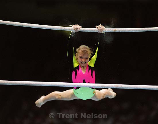 Gymnast on bars at Womens Team Gymnastics at the 1996 Summer Olympic Games<br />