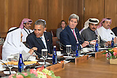 United States President Barack Obama (2nd-L) talks to Sheikh Sabah Al-Ahmed Al-Jaber Al-Sabah, Amir of the State of Kuwait, as Secretary of State John Kerry (2nd-R), Sheikh Tameem Bin Hamad Al-Thani, Amir of the State of Qatar and Dr. Khalid Bin Mohamed Al-Attiyah, Minister of Foreign Affairs, of Qatar, watch on during a working lunch at the Gulf Cooperation Council-U.S. summit at Camp David, the Presidential Retreat near Thurmont, Maryland, on May 14, 2015. Obama hosted leaders from Saudi Arabia, Kuwait, Bahrain, Qatar, the United Arab Emirates and Oman to discuss a range of issues including the Iran nuclear deal. <br /> Credit: Kevin Dietsch / Pool via CNP