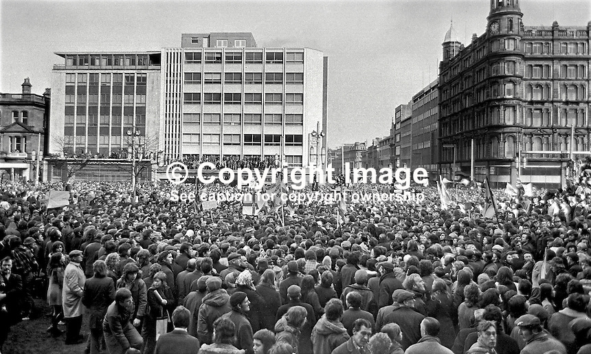 Thousands gather at the front of the City Hall, Belfast, in response to an Ulster Vanguard call for a 2 day strike to protest against the derogation of the N Ireland Parliament at Stormont and the introduction of direct rule by Westminster with the appointment of William Whitelaw as Secretary of State for N Ireland. Assembled gathering was address by William Craig, MP, leader, Ulster Vanguard. 197203270152a.<br />