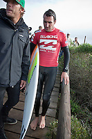JOEL PARKINSON (AUS)  after leaving the water during his heat with a fin cut to his foot. The injury required three stitches and didn't hinder Jole when he surfed later in the day.  JEFFREYS BAY, South Africa (Tuesday, July 14, 2009) - With clean, consistent 1.5-2.5 metre waves steaming through Jeffreys Bay today, competition was called on for the Billabong Pro Jeffreys Bay, with the first heats hitting the water at 7:45am.      Stop No. 5 of 10 on the 2009 ASP World Tour, the Billabong Pro Jeffreys Bay is running the new competition format, featuring elimination man-on-man matches from the outset, with yesterday seeing the completion of Round 1 as well as the opening two heats of Round 2.    Today Round 2 was completed along with four heats of Round 3. Standout surfing came from defending champion KELLY SLATER (USA), current world number 1 JOEL PARKINSON (AUS)  and MICHEL BOUREZ (PYF) who defeated Australian surfer and former winner  MICK FANNING (AUS).    Photo: joliphotos.com