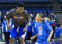16.01.2013 London, England. New York Knicks point guard Iman Shumpert (21) running basketball drills with youngsters as part of the NBA Cares outreach programme ahead of the NBA London Live 2013 game between the Detroit Pistons and the New York Knicks from The O2 Arena