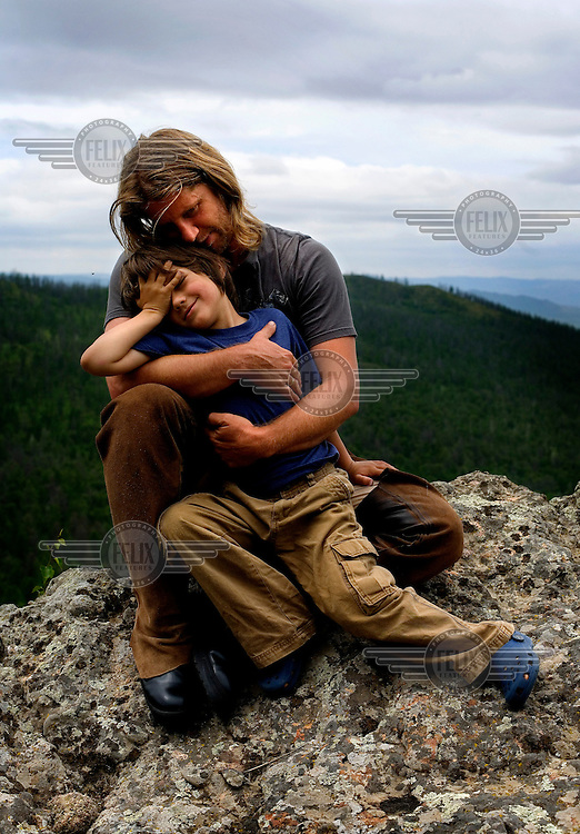 "Rupert Issacson, a campaigning writer and former horse trainer, embraces his five-year-old autistic son, Rowan, during a horseback expedition across Mongolia. Rowan, who has been nicknamed ""The Horse Boy"", embarked on a therapeutic journey of discovery with his parents to visit a succession of shaman healers in one of the most remote regions in the world. Following Rowan's positive response to a neighbour's horse, Betsy, and some reaction to treatment by healers, Rowan's parents hoped that the Mongolian shamanistic rituals along the route and the prolonged contact with horses would help to unlock their son's autism and assist his development.."