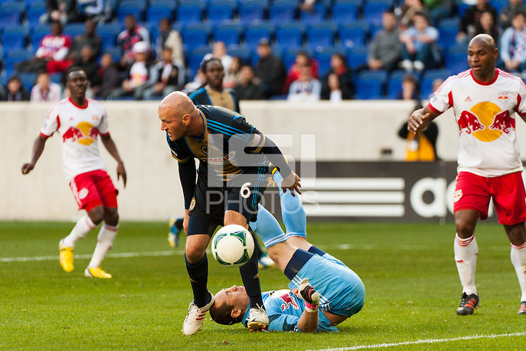 New York Red Bulls goalkeeper Luis Robles (31) lands on the ground after colliding with Conor Casey (6) of the Philadelphia Union. The New York Red Bulls defeated the Philadelphia Union 2-1 during a Major League Soccer (MLS) match at Red Bull Arena in Harrison, NJ, on March 30, 2013.