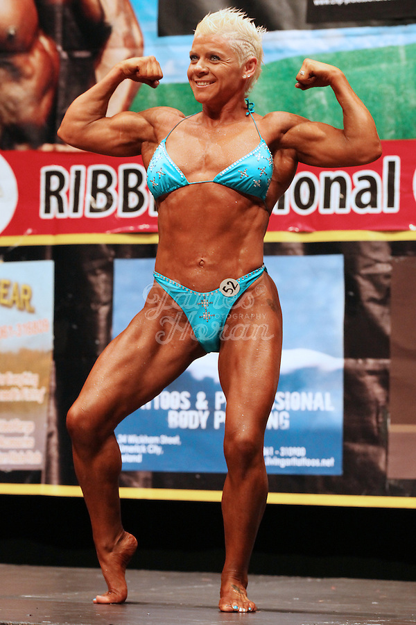 23/10/2010. Irish female physique and figure fitness national championships.  Angela Mc Namara (2nd place winner) from Limerick is pictured posing onstage during the female physique category as part of the 2010 RIBBF national bodybuilding championships at the University of Limerick Concert Hall, Limerick, Ireland. Picture James Horan.