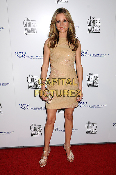 JESSALYN GILSIG .24th Annual Genesis Awards - Arrivals held at the Beverly Hilton Hotel, Beverly Hills, California, USA, 20th March 2010..full length beige dress cream rosette corsage flower sandals silk satin ruched clutch bag peach sleeveless .CAP/ADM/BP.©Byron Purvis/AdMedia/Capital Pictures.