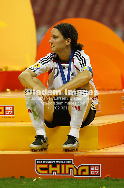SHANGHAI - SEPTEMBER 30:  Germany team captain Birgit Prinz relaxes on the medals platform after Germany defeated Brazil in the FIFA Women's World Cup soccer final September 30, 2007 in Shanghai, China.  (Photograph by Jonathan P. Larsen)