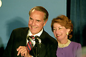 Former United States Senator Bob Dole (Republican of Kansas), the 1996 Republican Party candidate for President of the United States, makes his concession speech to supporters at an Election Night Party sponsored by the Republican National Committee at the Renaissance Hotel in Washington, DC on Tuesday, November 5, 1996.  Looking on at right is Dole's wife Elizabeth Dole.<br /> Credit: Ron Sachs / CNP