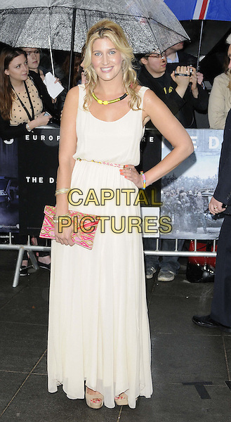 Francesca 'Cheska' Hull.'The Dark Knight Rises' European premiere at Odeon Leicester Square cinema, London, England..18th July 2012.full length white cream beige sleeveless dress clutch bag pink red necklace hand on hip.CAP/CAN.©Can Nguyen/Capital Pictures.