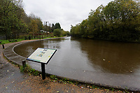 Pictured: Neath canal overflows into the flooded B4242 road between Resolven and Glyn Neath in south Wales, UK. Saturday 13 October 2018<br /> Re: Flooding caused by Storm Callum in the Neath area, south Wales, UK.