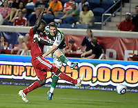 Portland forward Kenny Cooper (33) blast a shot out of the reach of Chicago forward Dominic Oduro (8).  The Portland Timbers defeated the Chicago Fire 1-0 at Toyota Park in Bridgeview, IL on July 16, 2011.