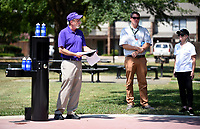 NWA Democrat-Gazette/DAVID GOTTSCHALK Amy Wilson (from right), director of public affairs with the Beaver Water District, and Matt Mihalevich, trails coordinator with the city of Fayetteville, listen  Monday, September 9, 2019, to Mayor Lioneld Jordan during a ceremony celebrating the installation of a hydration station in Sweetbriar Park in Fayetteville. Beaver Water District partnered with the city of Fayetteville to make the new hydration station in the park that is located near a newly completed section of the Niokaska Creek Trail.
