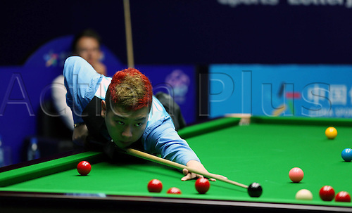 18.06.2013. Wuxi, China.   Li Hang of China   Against Judd Trump of England during their First Round of Snooker Wuxi Classic Match in Wuxi Chinas Jiangsu Province. Li Hang Won 5 2