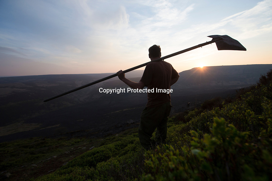 10/05/16 <br /> <br /> After eight hours of tackling a fire high up in a remote part of the Peak District between Sheffield and Manchester, game-keeper,  Kieron Logan, takes a moment to survey some 200 acres of precious heather moorland that was destroyed today after a BBQ started a fire in the valley below.<br /> <br /> Full story:   http://www.fstoppress.com/articles/peak-district-fire/<br /> <br /> .A small group of gamekeepers spent the night fighting a major blaze blaze covering two hundred acres of heather moorland close to the Derwent and Ladybower reservoirs in the Derbyshire Peak District.<br /> <br /> The fire, which broke out at around 1pm on Monday, is believed to have been started by a disposable barbecue, according to a spokesman for the reservoir, which quickly escalated into a major fire threatening the natural habitat of many wild animals and birds including red grouse, plovers, meadow pipits and hen harriers.<br /> <br /> Ten fire crews were called to tackle the flames, and remained on scene until dusk fell, leaving the job of managing the fire overnight to the gamekeepers on scene.<br /> <br /> Kieran Logan was one of the gamekeepers left battling the flames and he said moorland management policies implemented some 10 years ago by the landowners, The National Trust were also partly to blame.<br /> <br /> All Rights Reserved: F Stop Press Ltd. +44(0)1335 418365   +44 (0)7765 242650 www.fstoppress.com