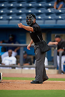 Umpire Matthew Brown asks for help on a call during a Southern League game between the Montgomery Biscuits and Biloxi Shuckers on May 8, 2019 at MGM Park in Biloxi, Mississippi.  Biloxi defeated Montgomery 4-2.  (Mike Janes/Four Seam Images)
