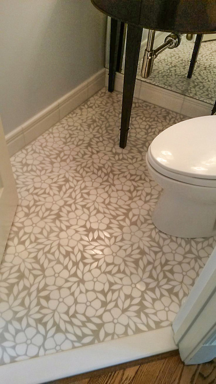 This custom bathroom floor features Jacqueline, a handmade floral mosaic shown in tumbled Thassos from the Silk Road Collection by Sara Baldwin for New Ravenna.<br /> <br /> For pricing samples and design help, click here: http://www.newravenna.com/showrooms/