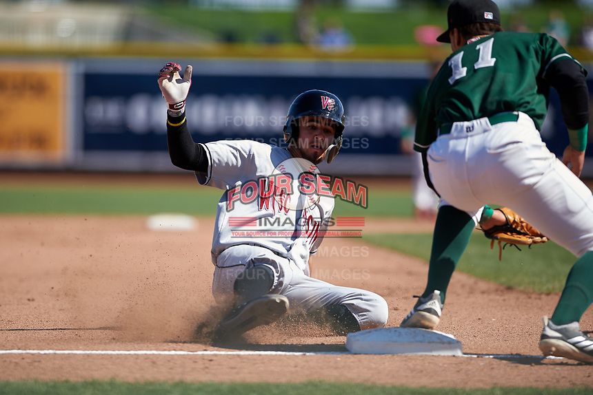 Wisconsin Timber Rattlers Antonio Pinero (3) slides into third base during a Midwest League game against the Great Lakes Loons at Dow Diamond on May 4, 2019 in Midland, Michigan. Great Lakes defeated Wisconsin 5-1. (Zachary Lucy/Four Seam Images)