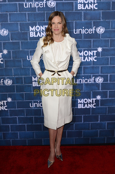 Hilary Swank.Montblanc Hosts Pre-Oscar Charity Brunch Benefiting UNICEF held at Hotel Bel-Air, Los Angeles, California, USA..February 23rd, 2013.full length dress white ruffle collar jacket coat silver pointy shoes belt gold hands in pockets .CAP/ADM/TW.©Tonya Wise/AdMedia/Capital Pictures